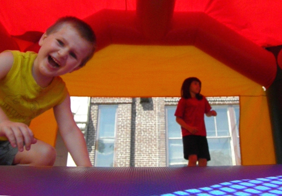 two children bounce house